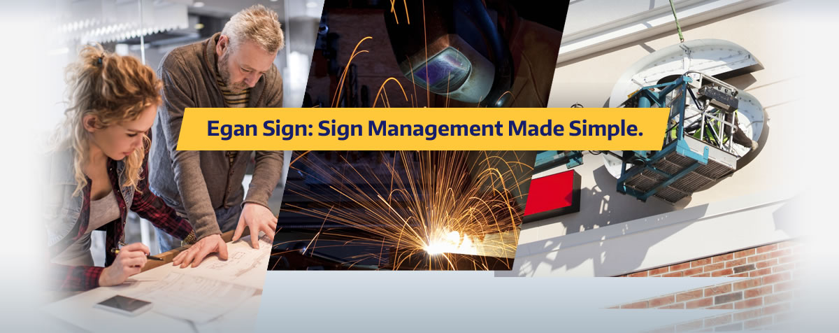 people working on signs for signage company