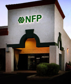 NFP storefront sign at night