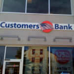 Customers Bank sign with flag