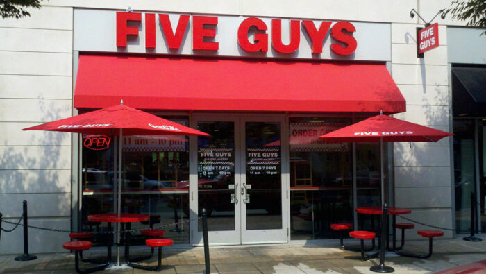 Five Guys Looking Good with Their Awning in Their Signature Red